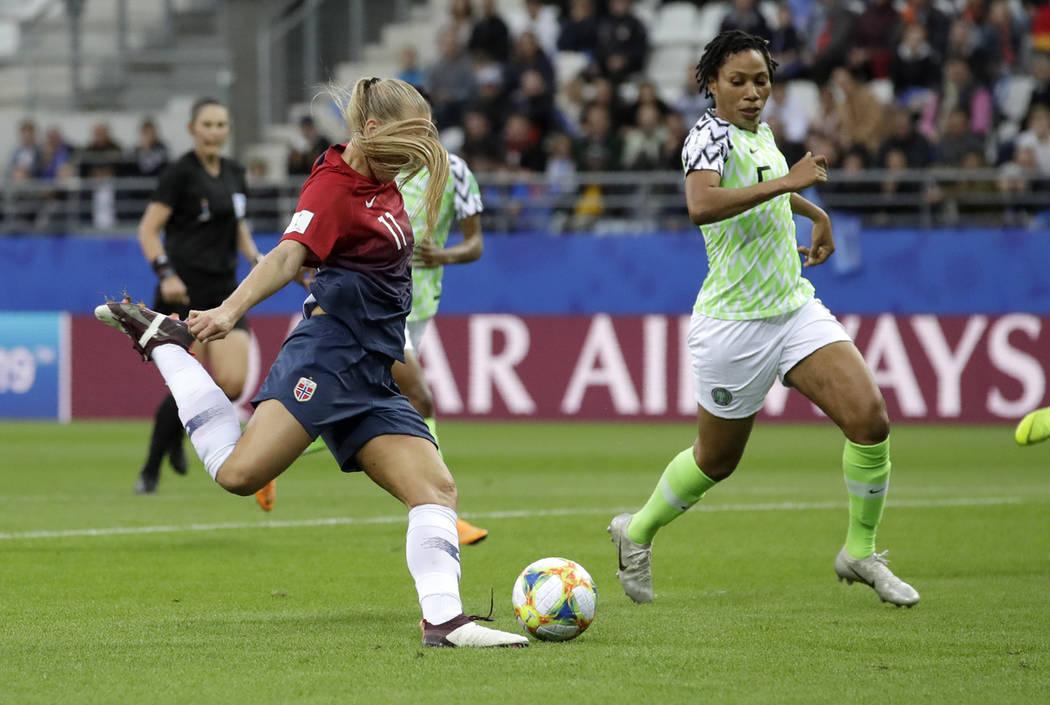 Norway's Lisa-Marie Utland, left, kicks the ball past Nigeria's Onome Ebi to score her team's s ...
