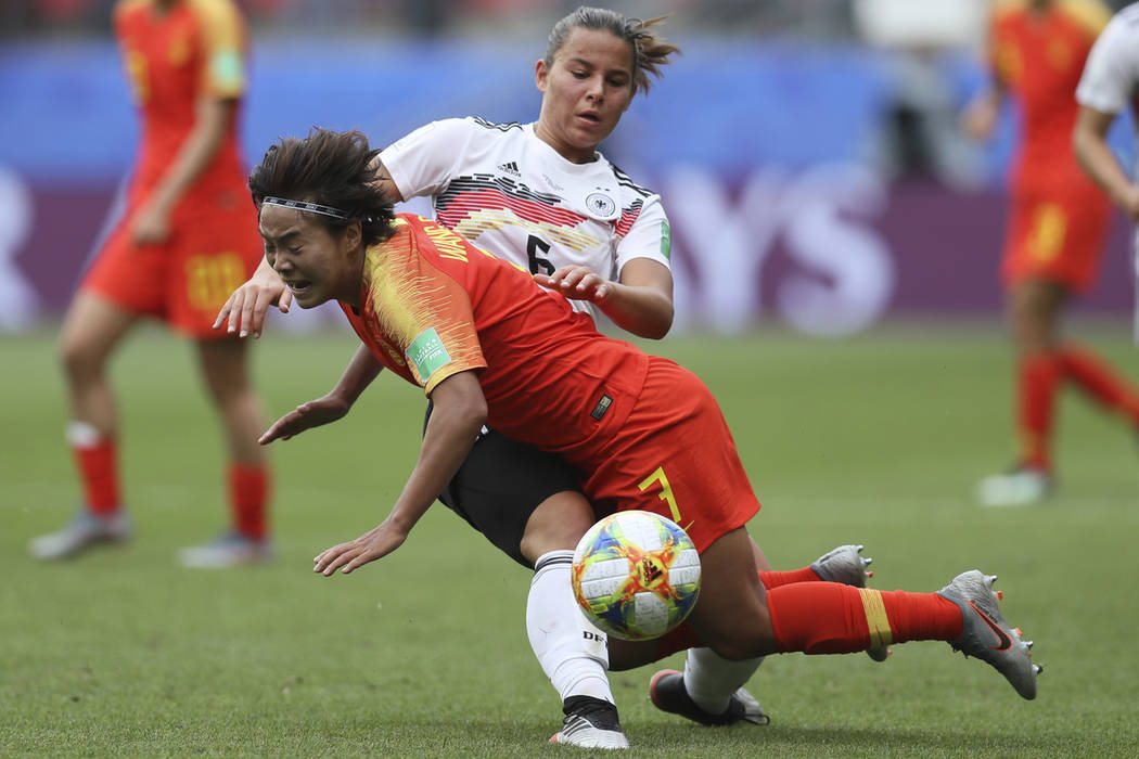 Germany's Lena Oberdorf, background, and China's Wang Shuang vie for the ball during the Women' ...