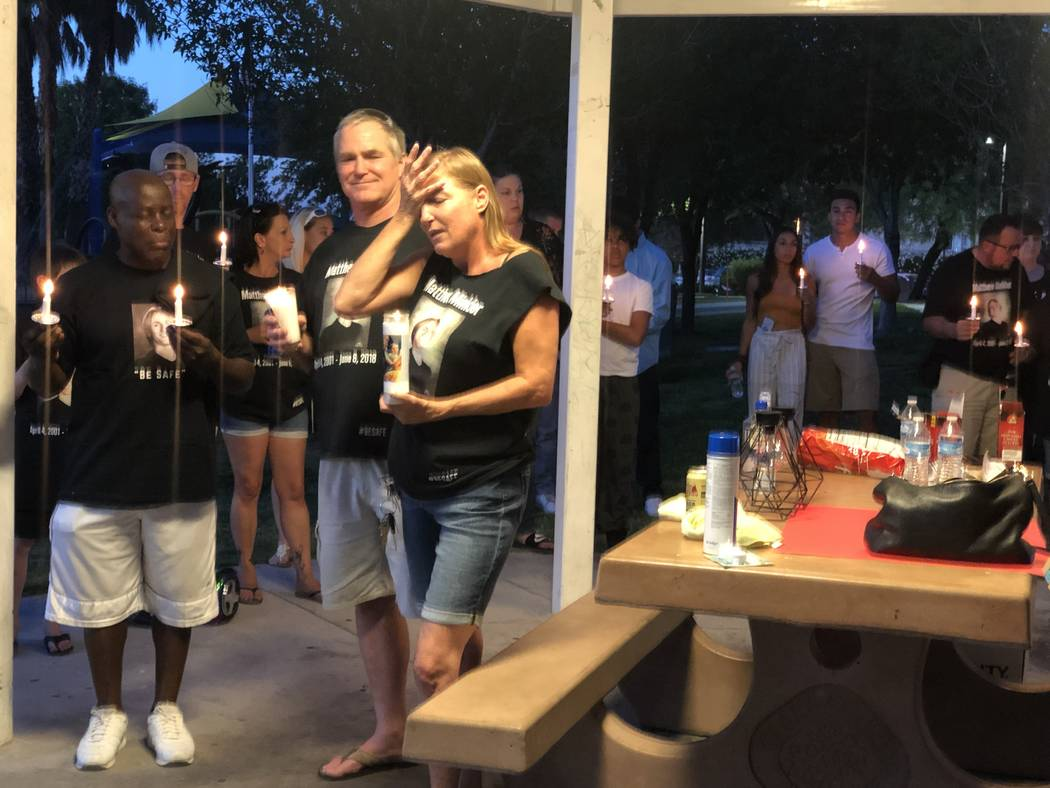Jamie Minkler, 53, stands next to her husband, 62-year-old Steven Minkler, during a vigil honor ...