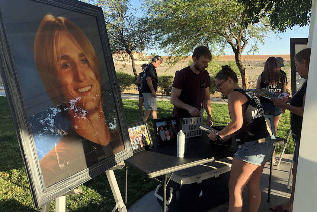 Desirea Roberts, 23, stands in front of a table while setting up a vigil at a Henderson park on ...