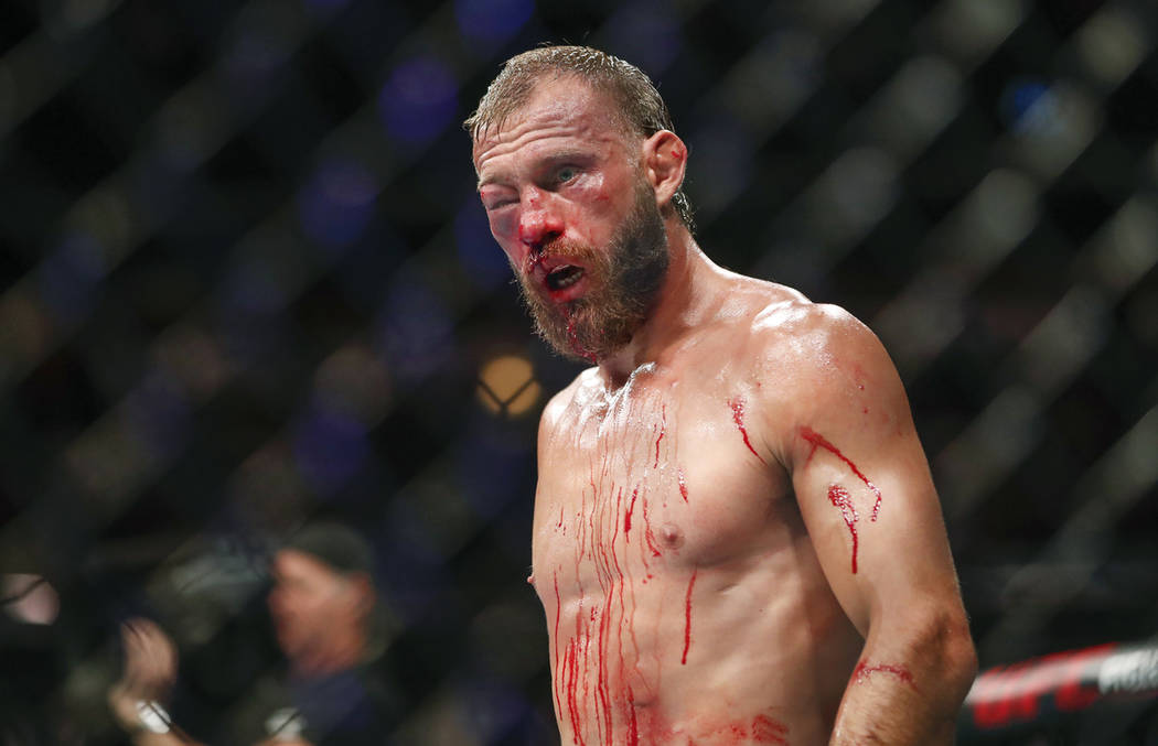 Donald Cerrone, his right eye swollen shut, is unable to fight Tony Ferguson during their light ...