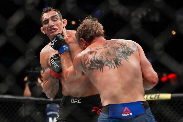 Donald Cerrone, right, lands a punch against Tony Ferguson during their lightweight mixed marti ...
