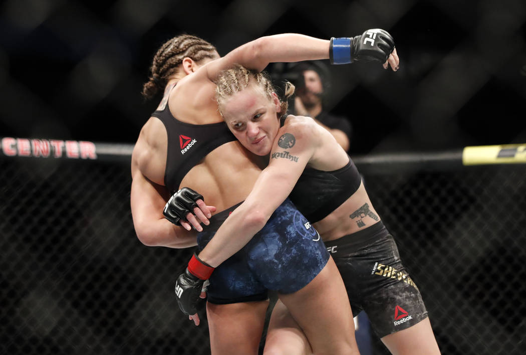 Valentina Shevchenko, right, tries to take down Jessica Eye during their women's flyweight titl ...