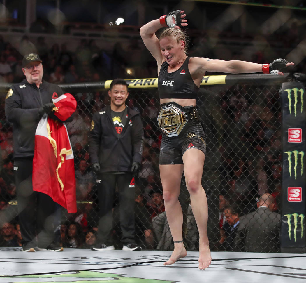 Valentina Shevchenko celebrates after defeating Jessica Eye during their women's flyweight titl ...