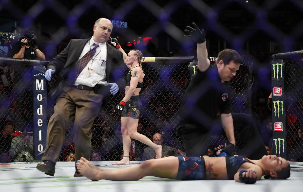 Valentina Shevchenko, rear, celebrates after knocking out Jessica Eye during their women's flyw ...