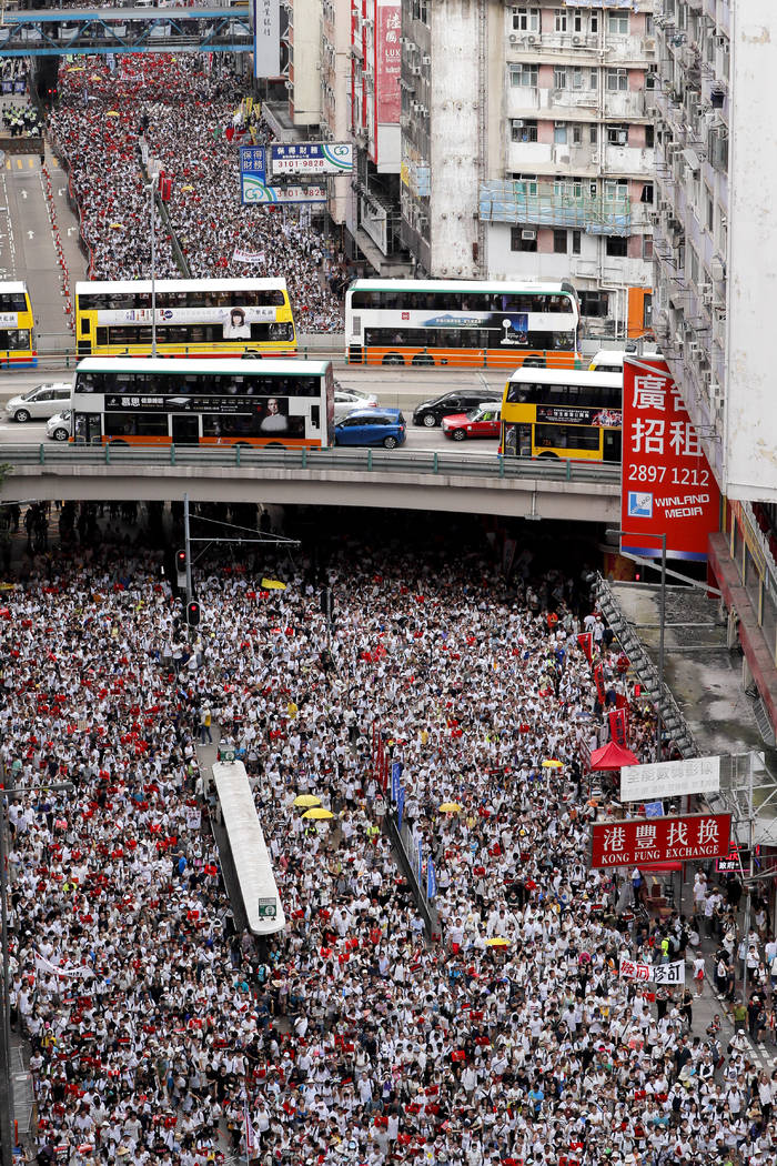 Protesters march in a rally against the proposed amendments to an extradition law in Hong Kong, ...