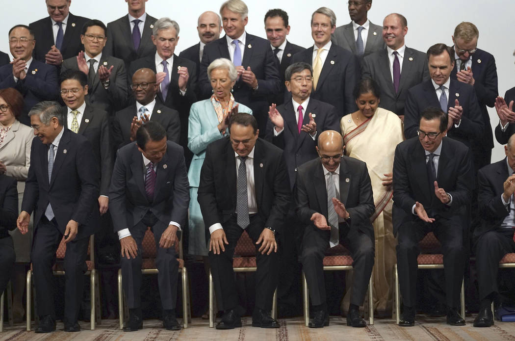 Participants finish their family photo session of the G20 finance ministers and central bank go ...