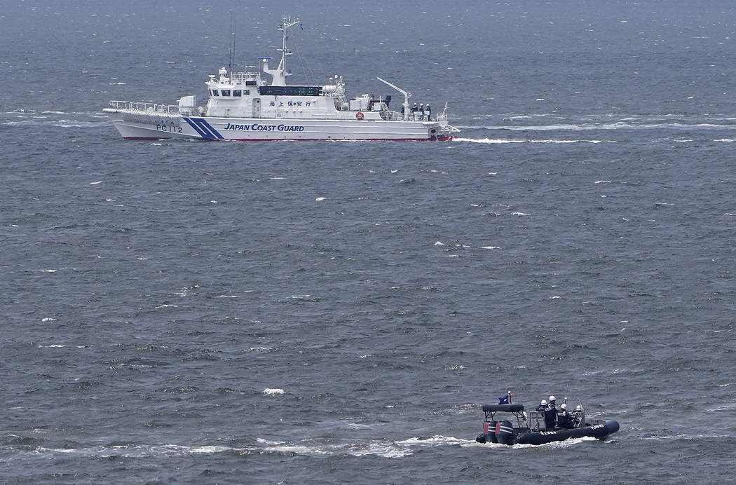 Japanese coast guard ship and security personnel patrol at sea near the venue of G20 Finance Mi ...