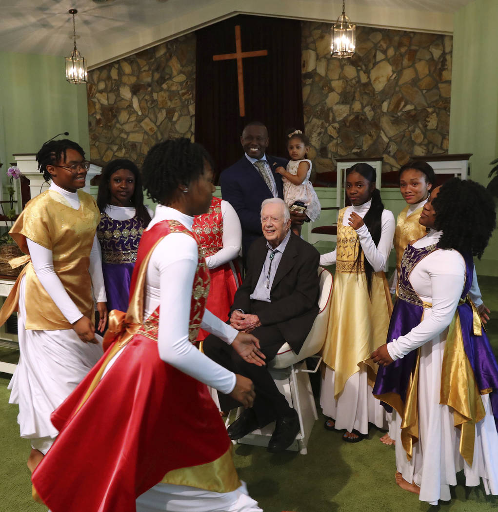 President Jimmy Carter has his picture taken with the Hayiya Dance Theatre, Inc. after they per ...