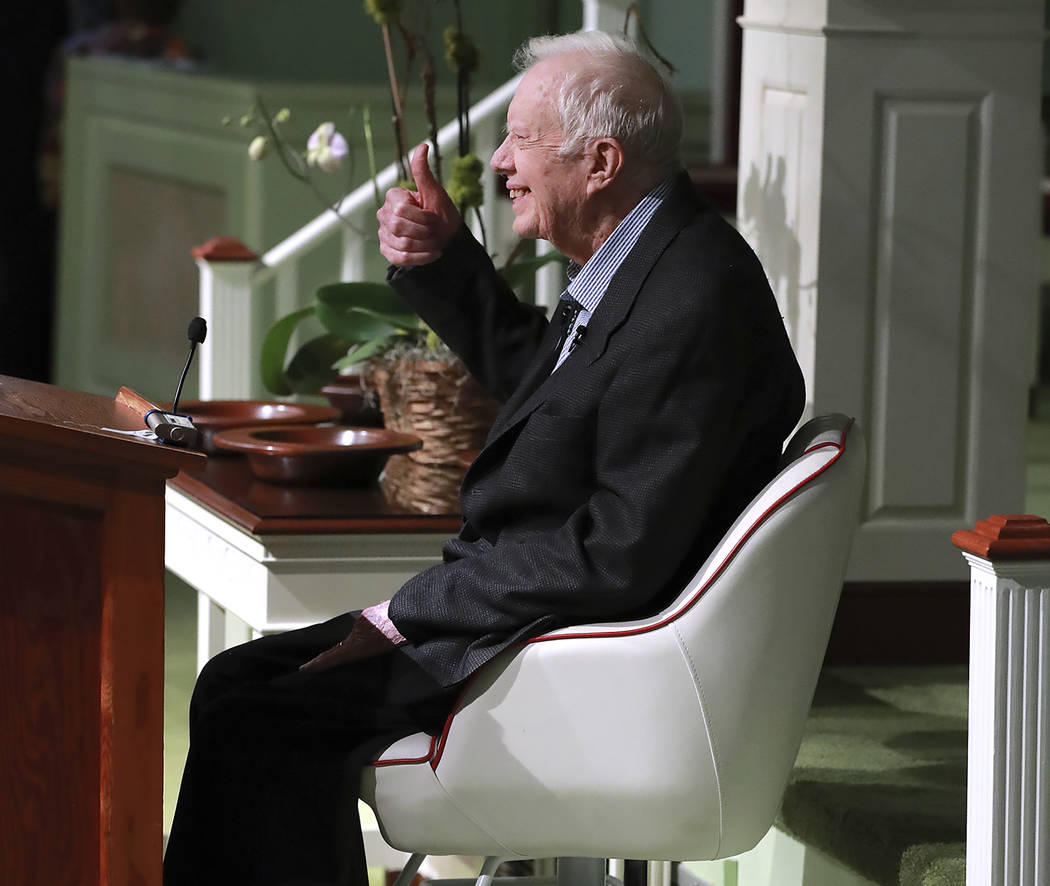 Former President Jimmy Carter smiles and gives the thumbs up as he returns to Maranatha Baptist ...