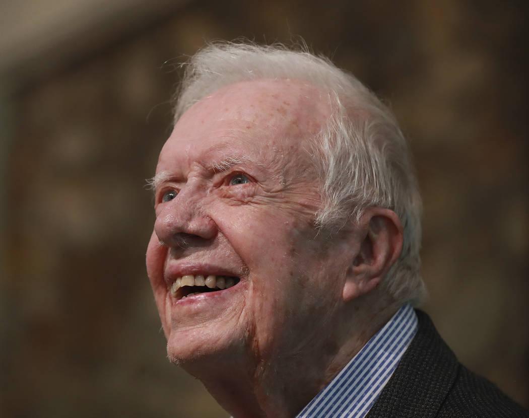 Former President Jimmy Carter smiles as he returns to Maranatha Baptist Church to teach Sunday ...