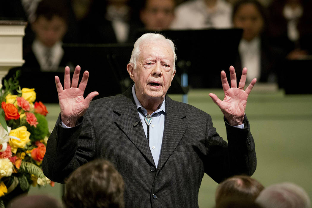 FILE - In this Sunday, Aug. 23, 2015 file photo, former President Jimmy Carter teaches Sunday S ...