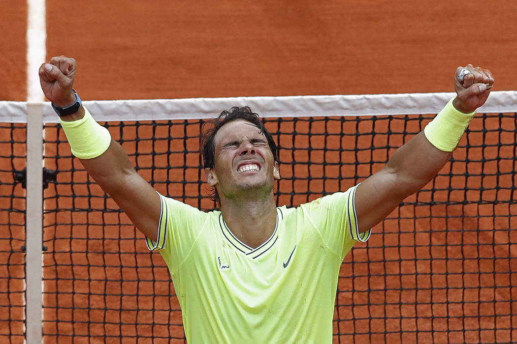Spain's Rafael Nadal celebrates his record 12th French Open tennis tournament title after winni ...
