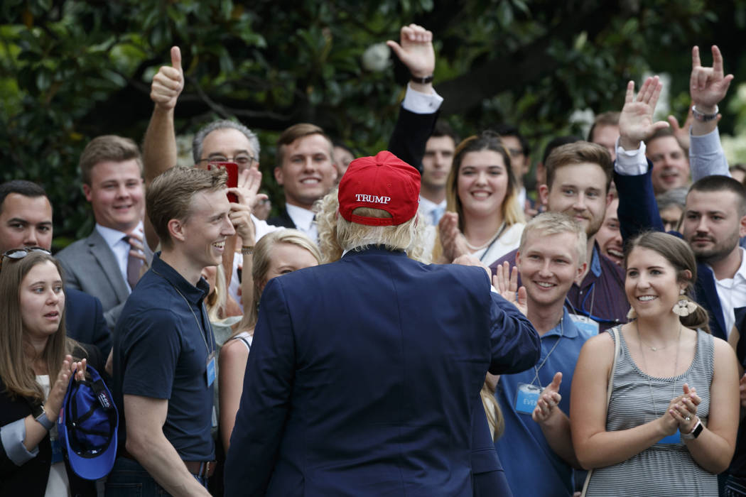 President Donald Trump greets supporters on his return to the White House, Friday June 7, 2019, ...