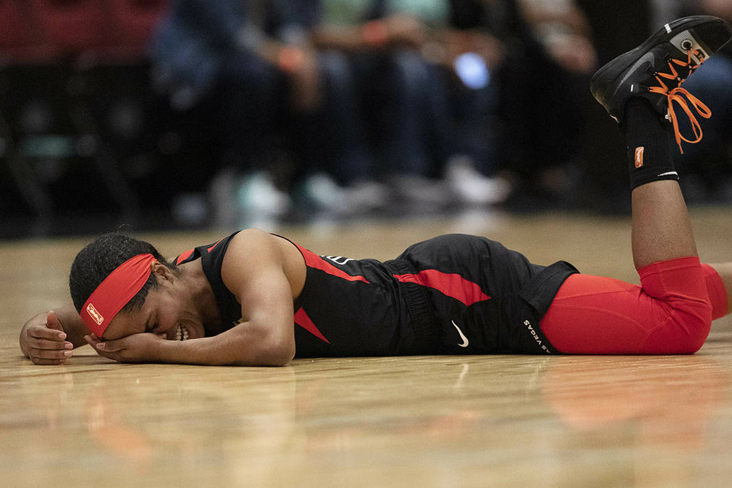 Las Vegas Aces' Sydney Colson lies on the court after being injured in the first quarter of a W ...