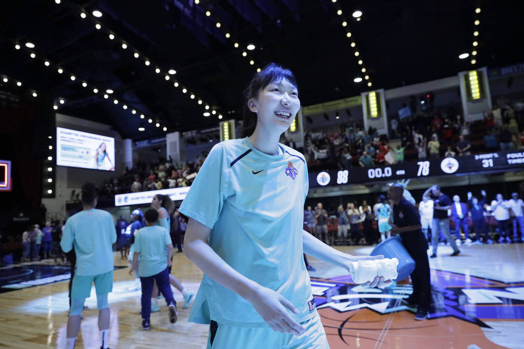 New York Liberty's Han Xu, of China, gets ready to throw a souvenir towel to fans after her tea ...