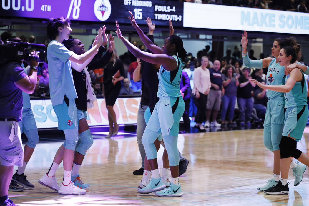 The New York Liberty celebrate after defeating the Las Vegas Aces in a WNBA basketball game, Su ...