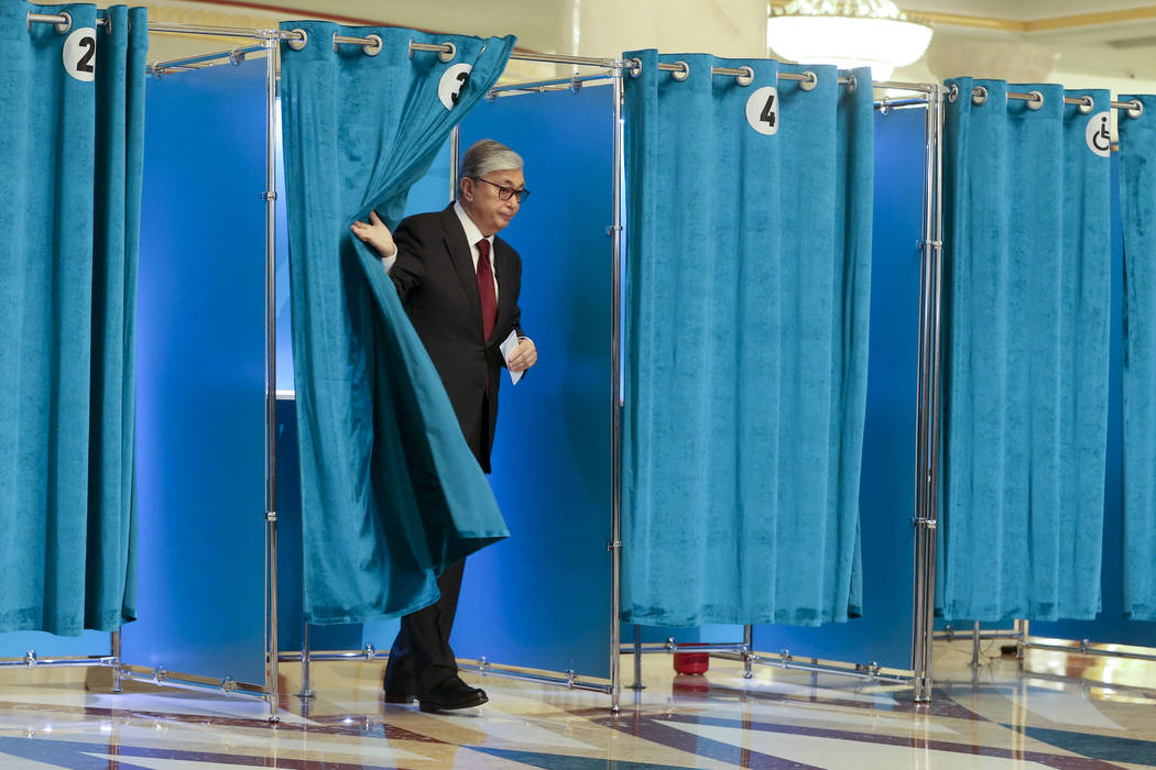 Kazakhstan's acting President Kassym-Jomart Tokayev leaves a booth at a polling station during ...