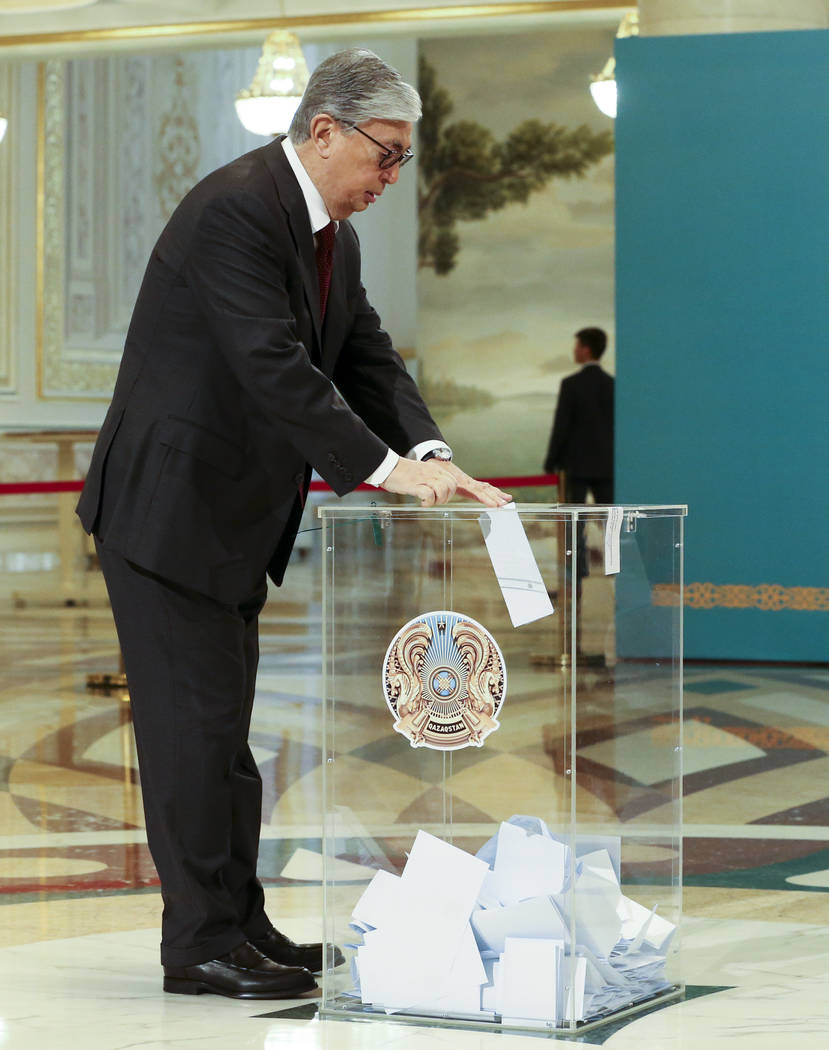 Kazakhstan's acting President Kassym-Jomart Tokayev casts his ballot at a polling station durin ...