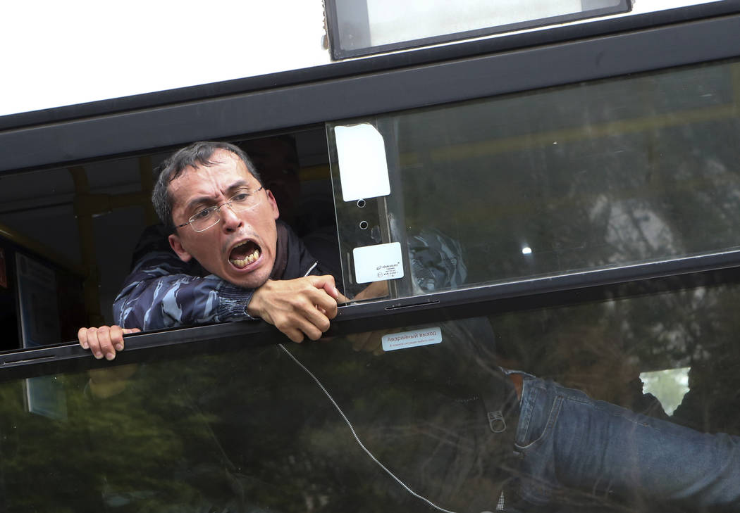A detained demonstrator shouts from a police bus during an anti-government protest during the p ...