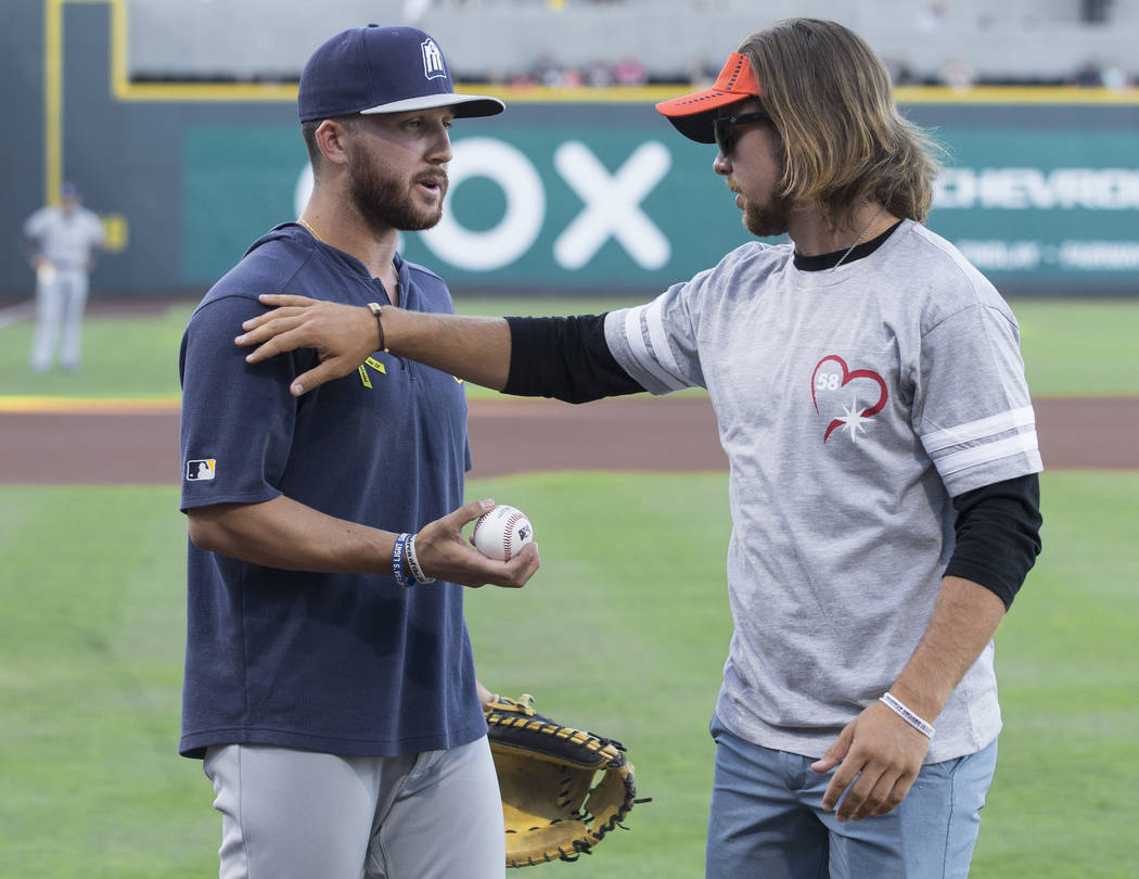 Kaden Manczuk throws out the first pitch before the start of the Las Vegas Aviators Triple A ba ...