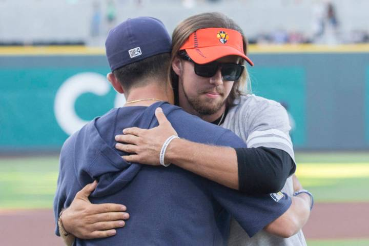 Kaden Manczuk, right, hugs San Antonio Missions pitcher Bubba Derby after Manczuk threw out the ...