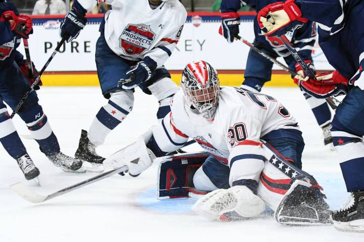 Team Langenbrunner goalie Spencer Knight (30) kicks the puck into the corner during the USA Hoc ...