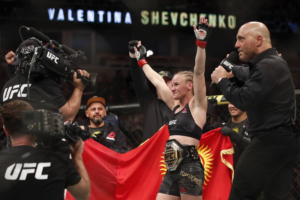 Valentina Shevchenko celebrates after defeating Jessica Eye during their women's flyweight titl ...