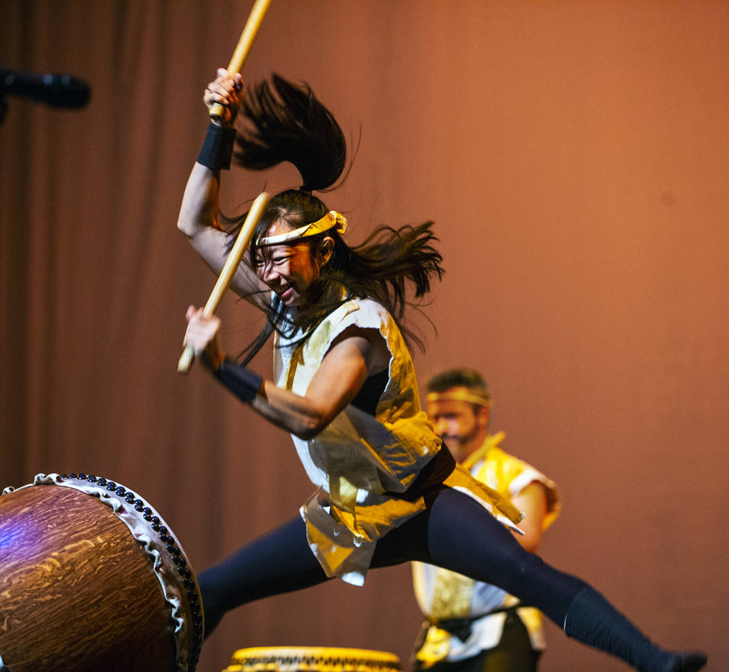 Jen Kong with Korabo jumps while performing the traditional Japanese art form of taiko for a pa ...