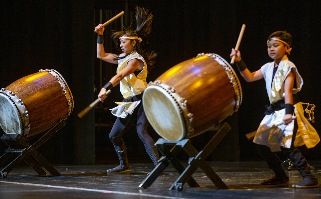 Jen Kong and Elijah Rondez, 9, with Korabo perform the traditional Japanese art form of taiko f ...
