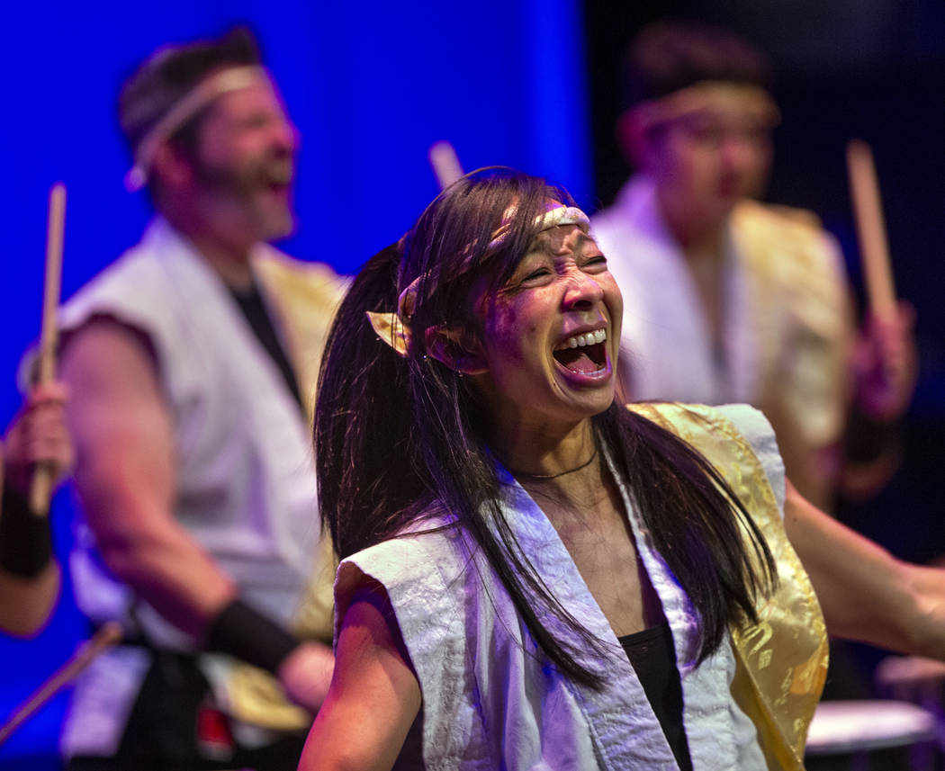 Jen Kong with Korabo yells while performing the traditional Japanese art form of taiko for a pa ...