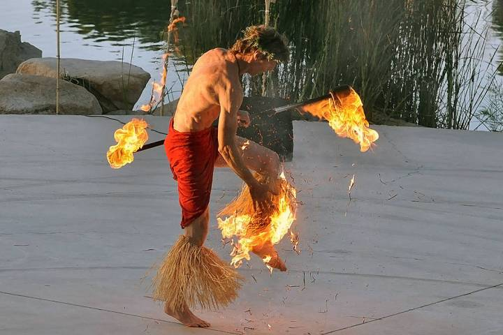 A fire dancer's costume catches fire while performing at a luau outside the Lakeside casino in ...
