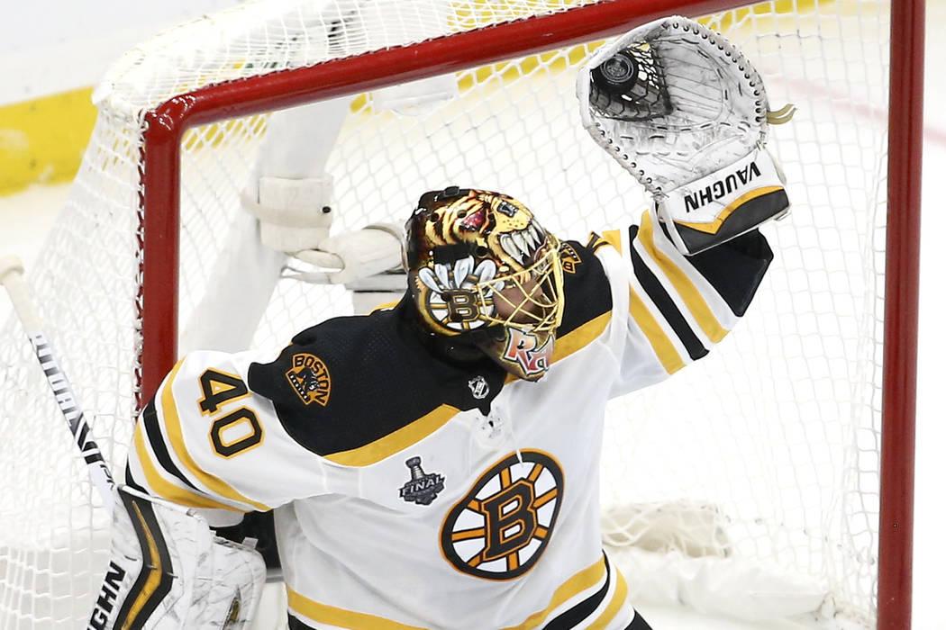 Boston Bruins goaltender Tuukka Rask, of Finland, gloves a shot against the St. Louis Blues dur ...