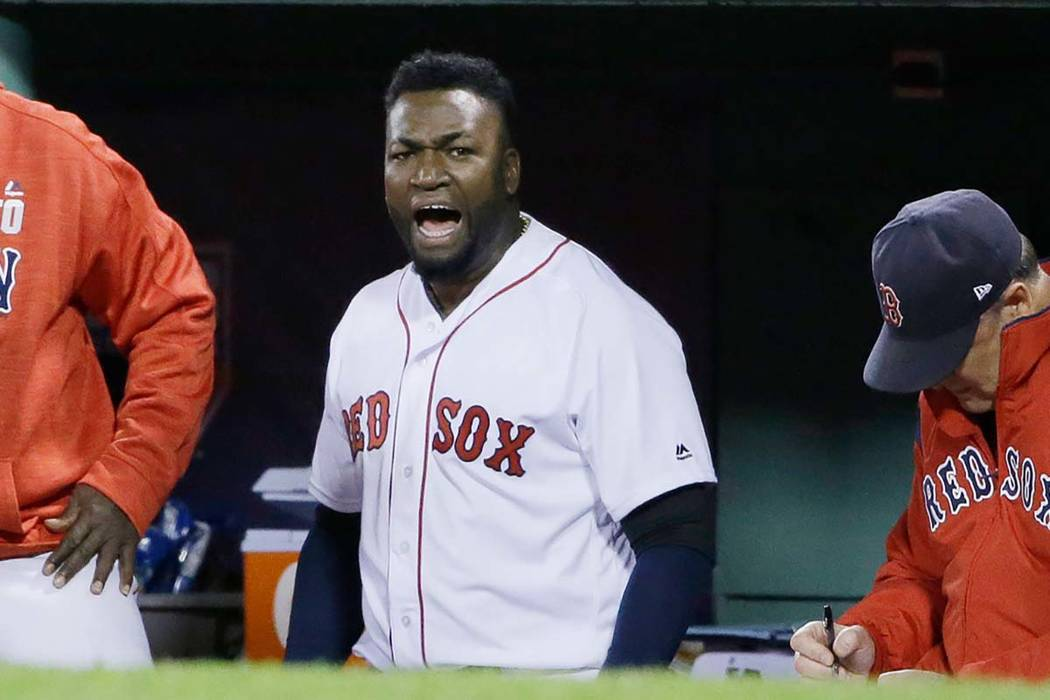 In this Oct. 10, 2016, file photo, Boston Red Sox designated hitter David Ortiz encourages the ...