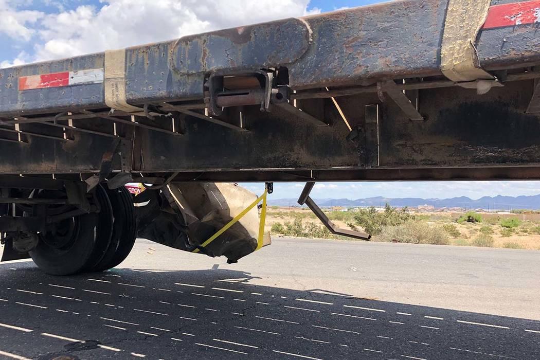 The Nevada Highway Patrol investigates a crash involving a semitrailer hauling double trailers ...
