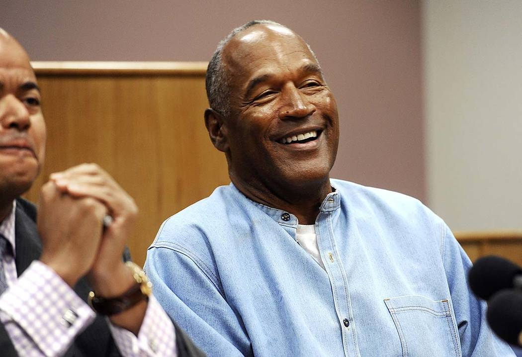 FILE - In this July 20, 2017, file photo, former NFL football star O.J. Simpson reacts after le ...