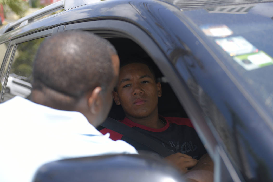D'Angelo Ortiz, son of former Boston Red Sox slugger David Ortiz, sits in a vehicle outside the ...