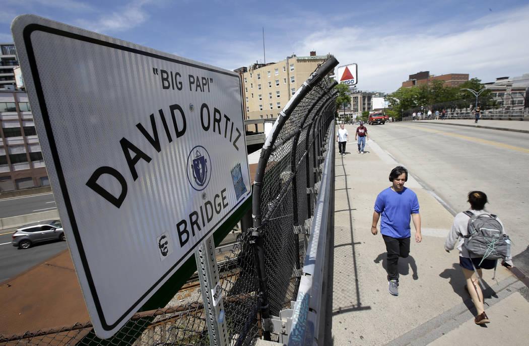 Passers-by walk over a bridge named for former Boston Red Sox slugger David Ortiz near Fenway P ...