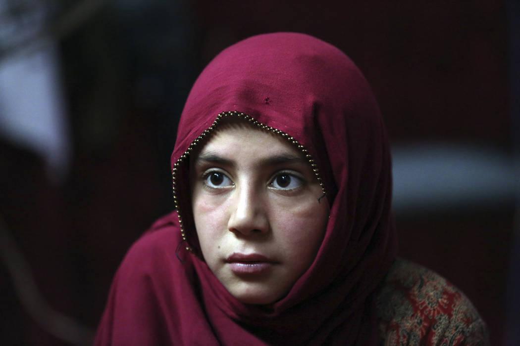 In this Thursday, May 30, 2019 photo, Shoghla, daughter of Farmanullah Shirzad whose family fl ...
