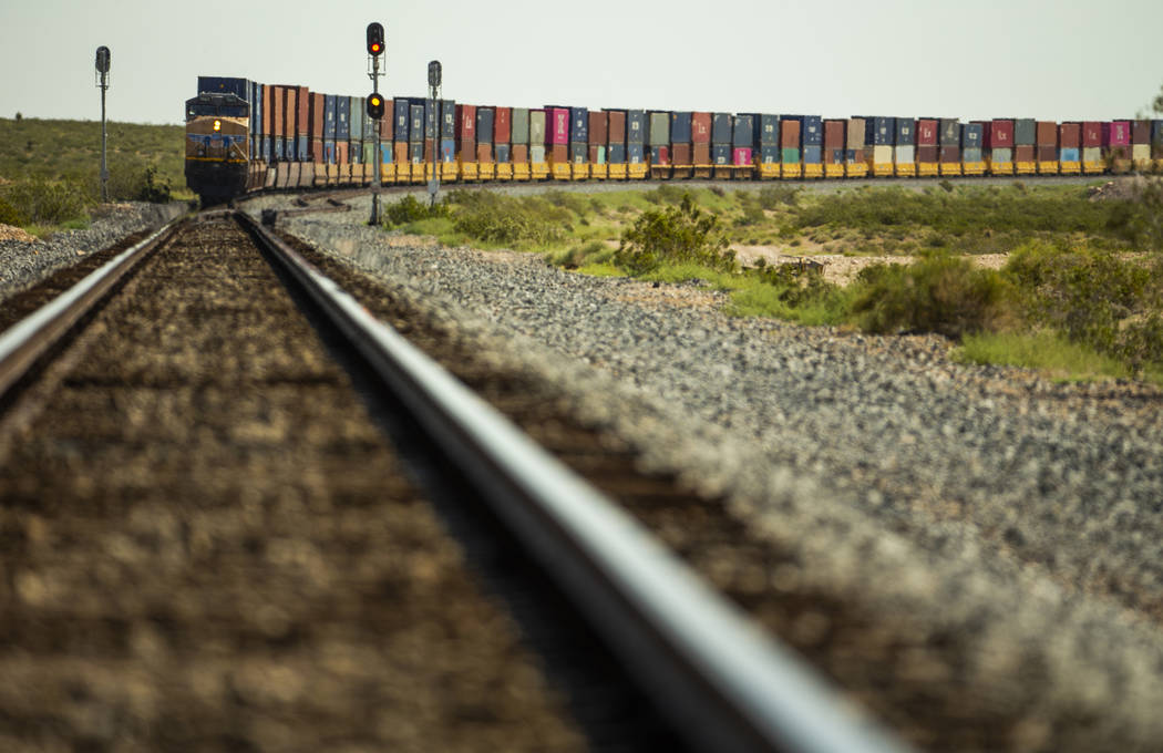A train carrying stacks of containers makes its way northbound near the Jean dry lake bed on Mo ...