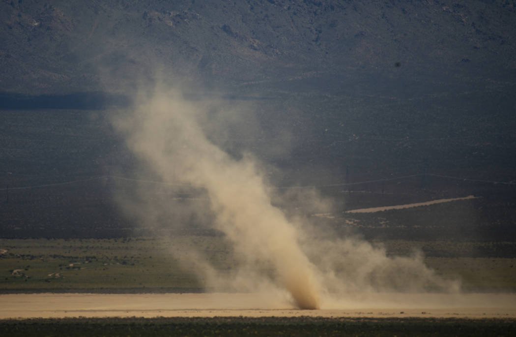 A dust devil swirls about the Jean Dry Lake bed as winds are still steady in the desert there o ...