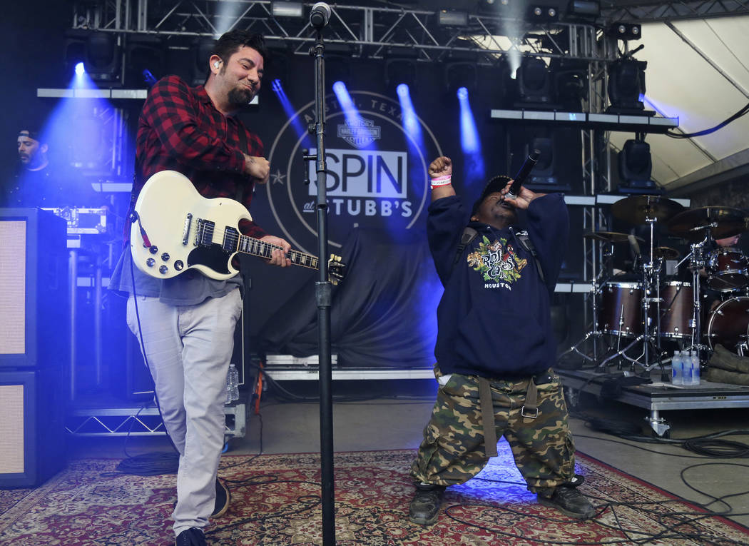 FILE - In this March 18, 2016, photo Bushwick Bill, right, joins Deftones' Chino Moreno onstage ...