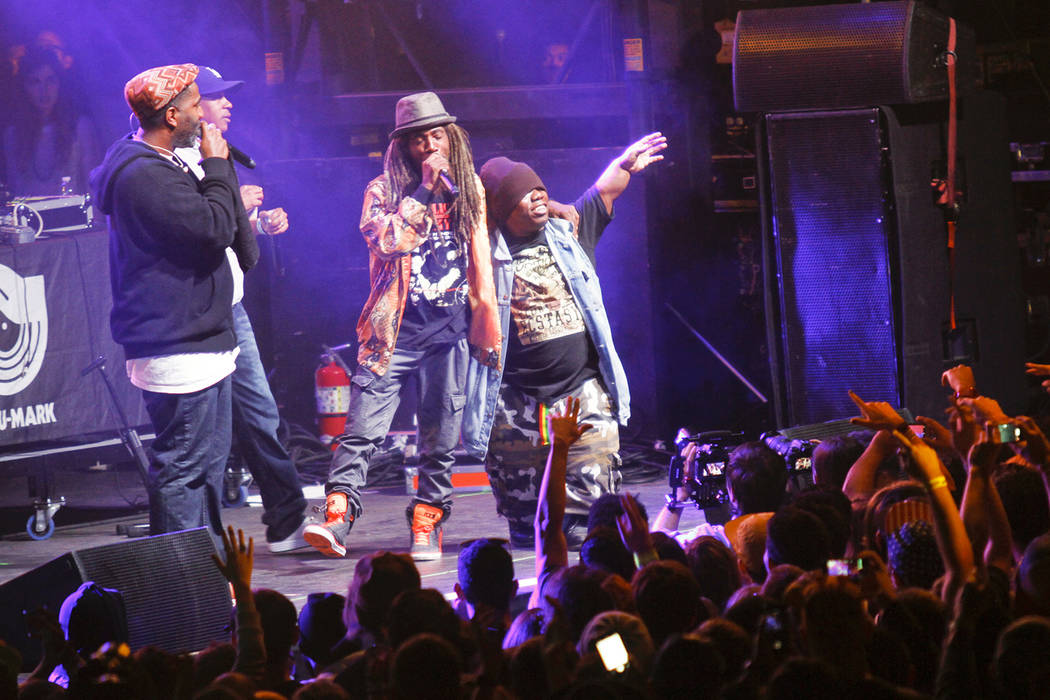 Bushwick Bill, right, joins Jurassic 5's Zaakir, Mark 7even, and Akil, from left, onstage durin ...