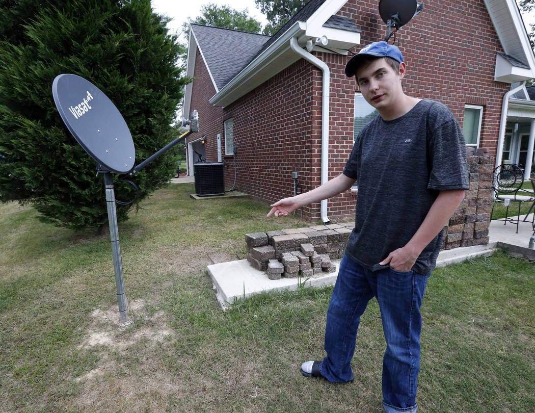 In this May 8, 2019, photo, Riley Shaw talks about his family's internet at his home outside St ...