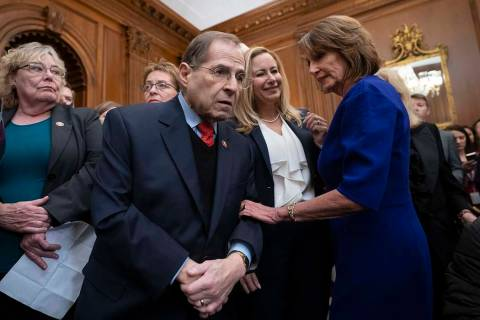 FILE - In this Jan. 4, 2019, Speaker of the House Nancy Pelosi, D-Calif., right, htalks with Re ...