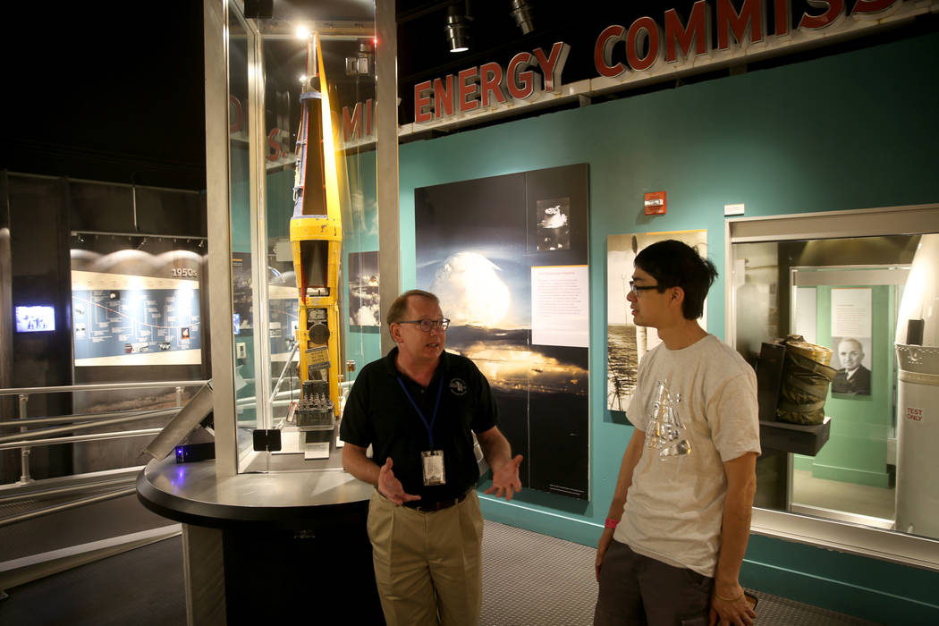 Executive Director Michael Hall of the National Atomic Testing Museum in Las Vegas, left, talks ...