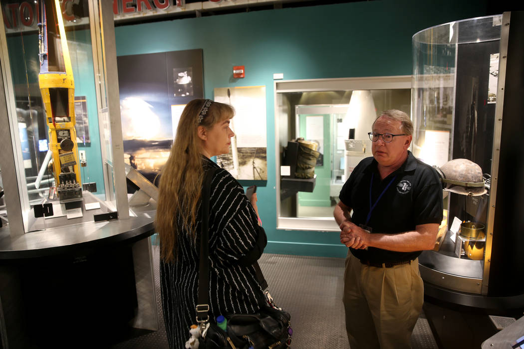 Executive Director Michael Hall of the National Atomic Testing Museum in Las Vegas, right, talk ...