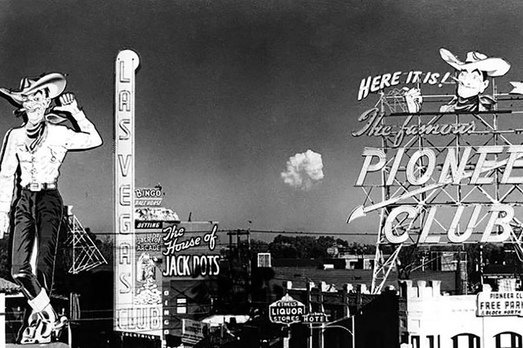 In this November 1951, Las Vegas News Bureau file photo, a mushroom cloud expands above the des ...
