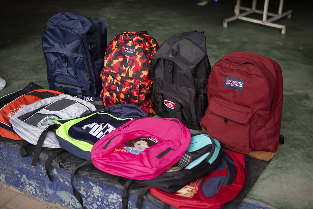 In this June 8, 2019, photo, backpacks lie for sale inside a store at the bus terminal in San M ...