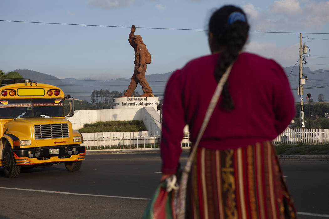In this June 7, 2019, photo, a Quiche indigenous woman stands facing a monument that pays homag ...